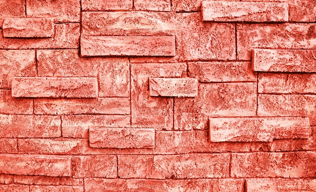 トーンのサンゴ色レンガの壁のテクスチャグランジ背景。