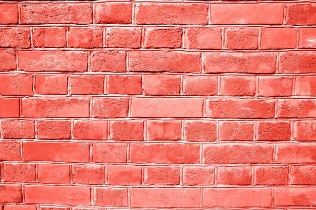 コーラルレンガの壁のテクスチャ背景。