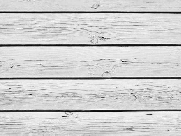 古い白い割れた木製の厚板