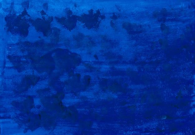 カラフルな濃い青のインク。水彩テクスチャバックグラウンド