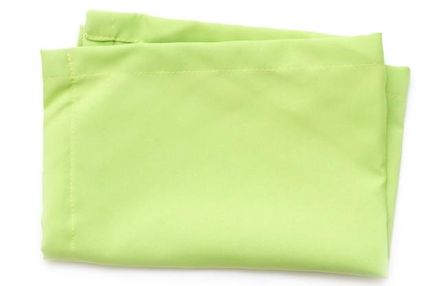 分離された白い表面に緑のナプキン