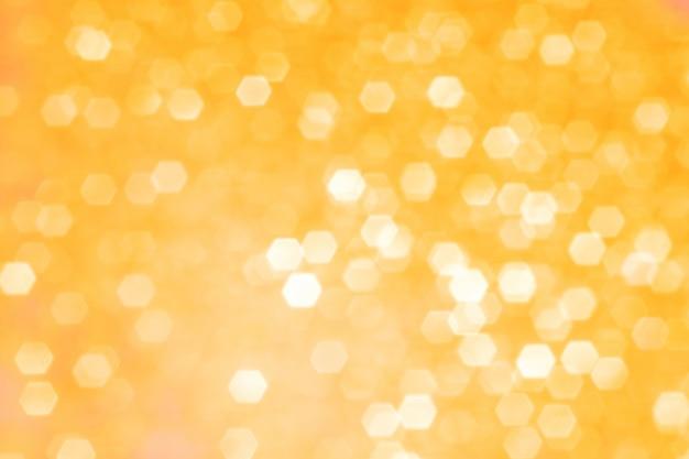 金色の輝きと背景をぼかし。