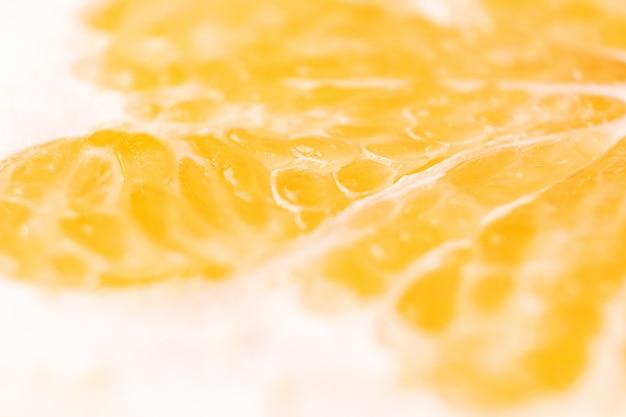 明るいジューシーな柑橘類パルプのクローズアップ。