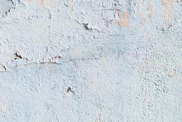傷や亀裂を持つ青い質感。青い背景青と白の模様