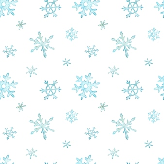 ライトブルーの立ち下がり雪のクリスマスのパターン。冬の背景。水彩のクリスマスイラスト。