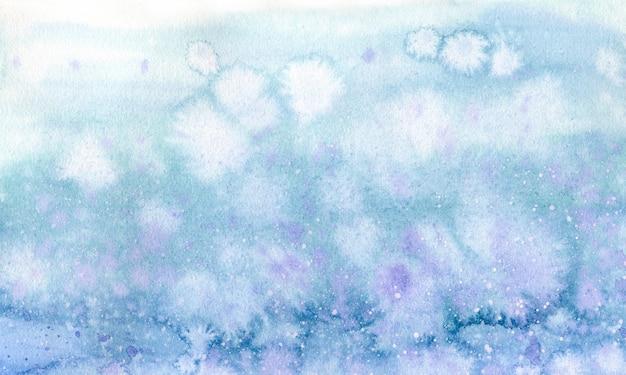 水彩の青と紫の背景に水をはねたデザインと印刷。空や雪の手描きイラスト。