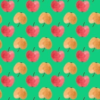 赤と黄色の水彩りんごとのシームレスなパターン。