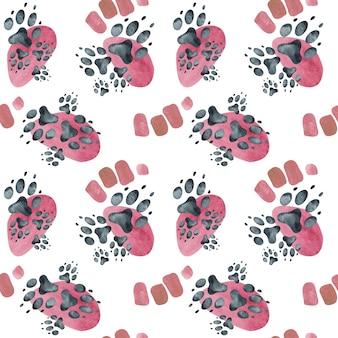 ピンクの斑点に犬の足跡のシームレスパターン。水彩イラスト。
