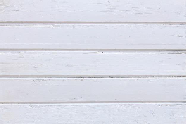 ホワイトウッドテクスチャ背景。グランジの木製の壁のパターン。