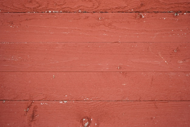 美しい木製の背景。赤い色の木造住宅の一部。