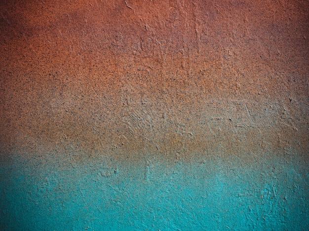 古い石ヴィンテージマルチカラー壁:オレンジ、青の色。