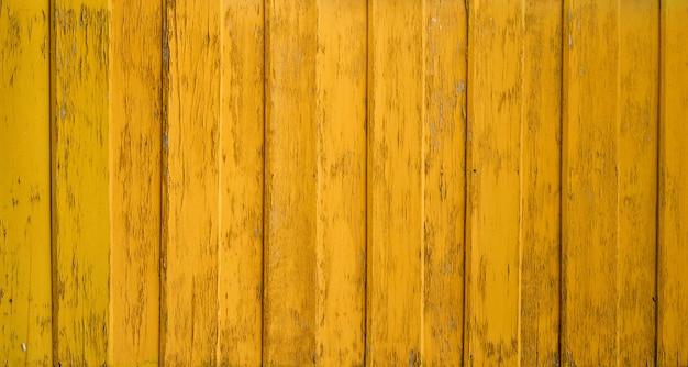 黄色の壁木製テクスチャ背景