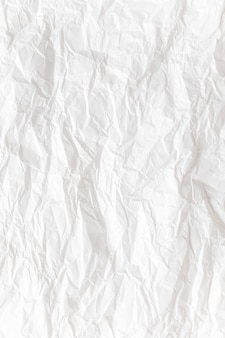 白い紙を丸めてテクスチャ背景を閉じる