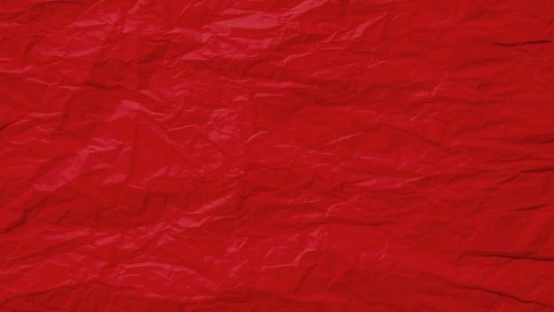 紙ページテクスチャの大まかな背景を持つ古いしわくちゃの赤。しわグランジ羊皮紙パターンビンテージデザイン。