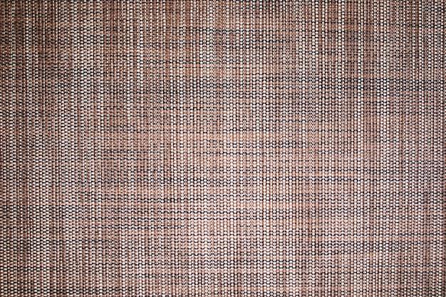 Коричневый фон текстуры ткани. деталь канва текстильного материала