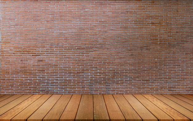 木製の床と背景のスペースで赤レンガの壁