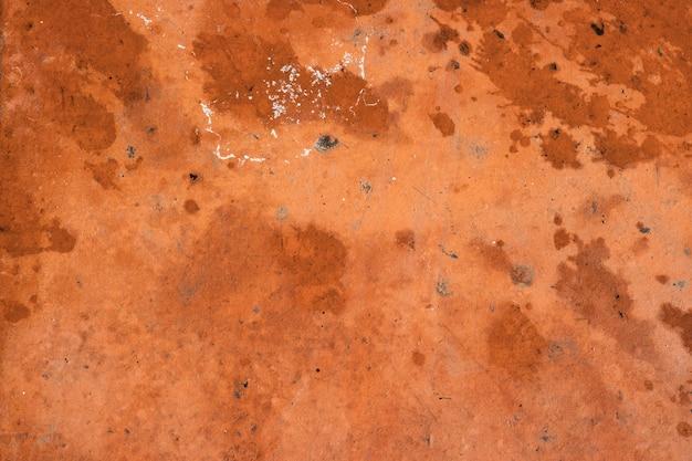 オレンジブラウンセメント壁のテクスチャ背景