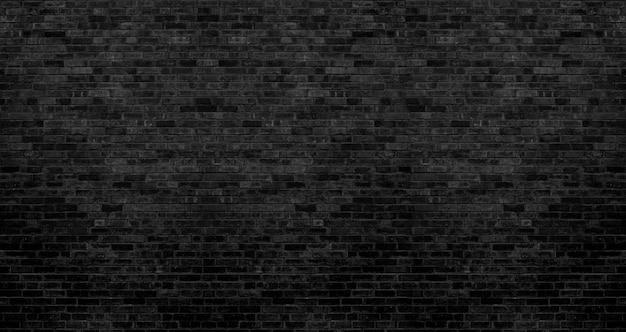 ダークブラックのレンガの壁の質感、背景のレンガの表面