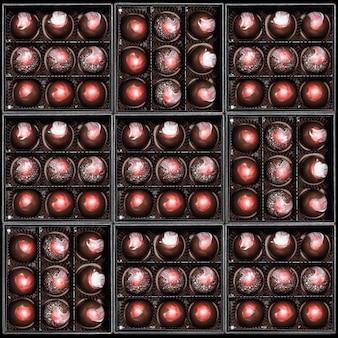 ギフトボックスのチョコレート菓子。ギフトボックスに入ったチョコレート菓子の詰め合わせ。カラフルなチョコレートボンボンのセットです。平面図、フレーレイ。