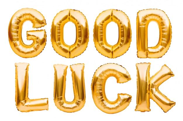 Слова удачи сделанные из золотых раздувных изолированных воздушных шаров на белизне. гелиевые шарики золотая фольга, открытка для мужества и выздоровления. желаем удачи
