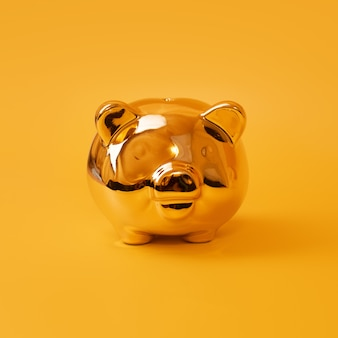 黄色の背景、節約、貯金箱に黄金の貯金箱