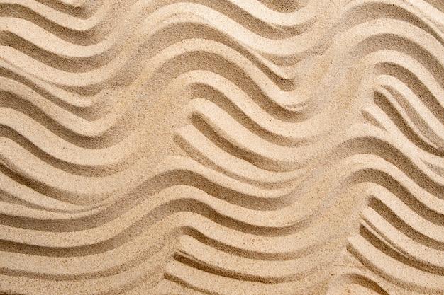 ビーチ、自然表面の背景にテクスチャライン波砂