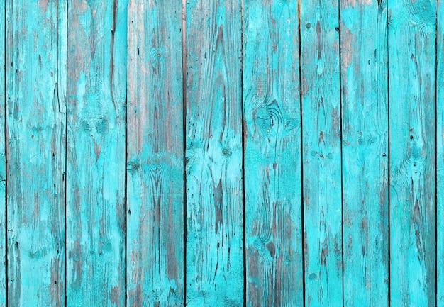 ターコイズブルーの木製の背景。木の自然な背景。古い木の質感。