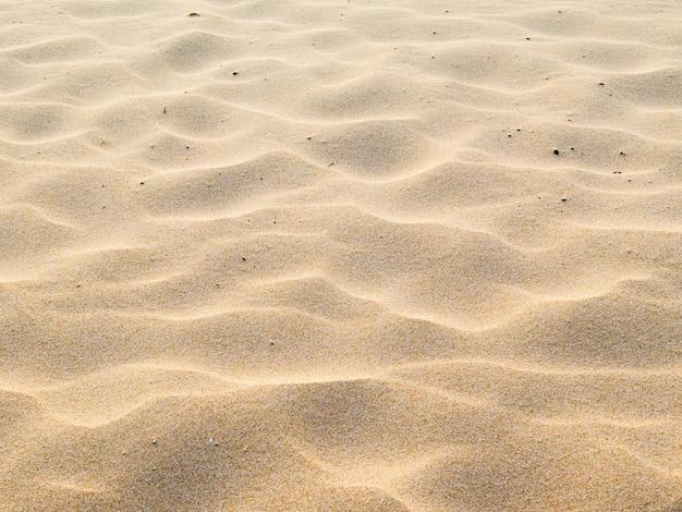 Песок на пляже в качестве фона