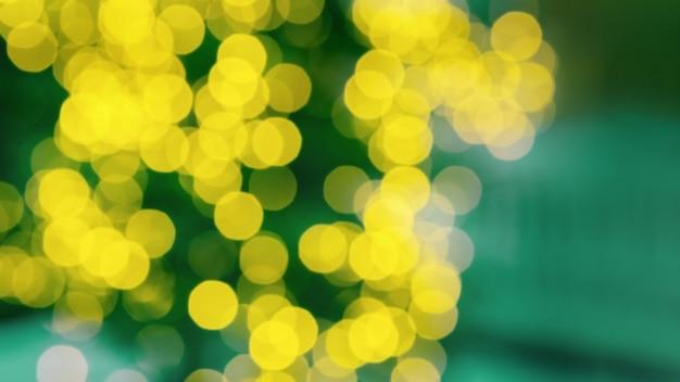 クリスマスツリーが点灯します。ボケ抽象的なテクスチャ。明るい黄色の輝きと新年バナー。