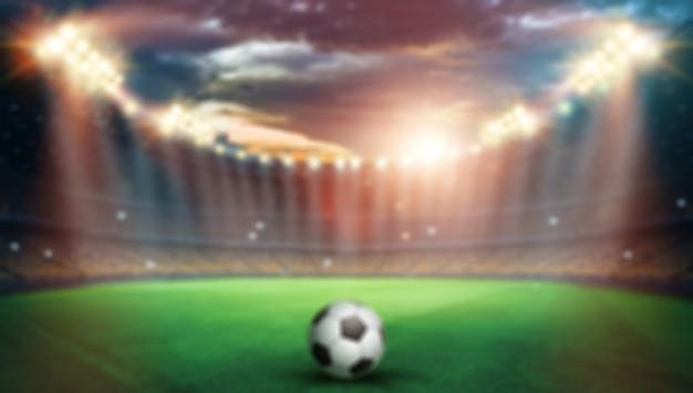Размыто, стадион в огнях и вспышках, футбольное поле