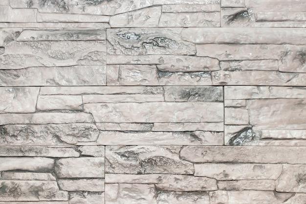 石の壁の明るい灰色のテクスチャ。