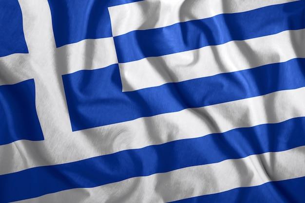 ギリシャの旗が風になびいて