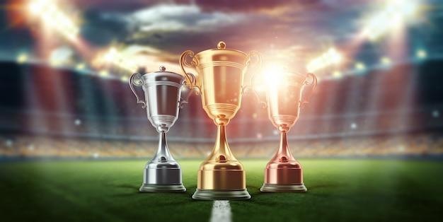 Золотой кубок на фоне стадиона. концепция спорта, победы, награды. копировать пространство.