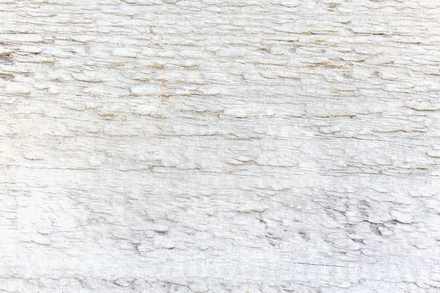 ひびの入ったと古い白い木製の背景