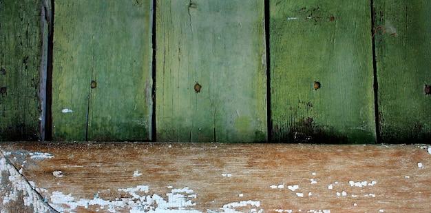古い木製の緑の背景