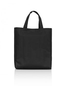 Пустая черная сумка из ткани на белом фоне