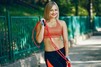 A beautiful girl is engaged in morning exercise in the park.