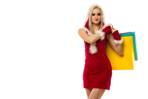 새 해의 드레스에 아름 다운 섹시 한 여자, 쇼핑 가방 흰색 절연 손에 개최. 크리스마스 또는 신년 세일 축하