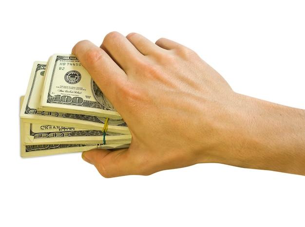 ビジネスマンの手に大きな山のお金