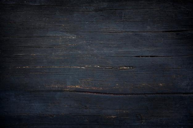 Черный фон из почерневших от дыма дубовых досок.