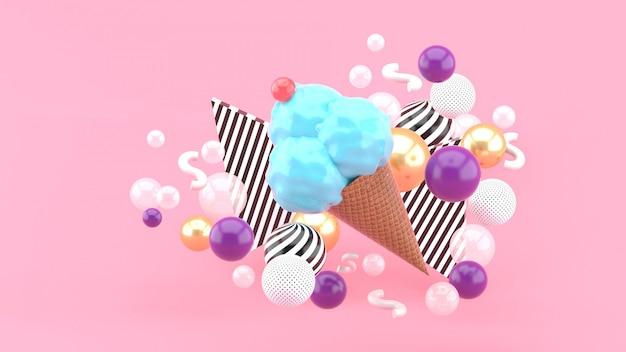 ピンク色のカラフルなボールに囲まれた青いアイスクリーム。 3dレンダリング。