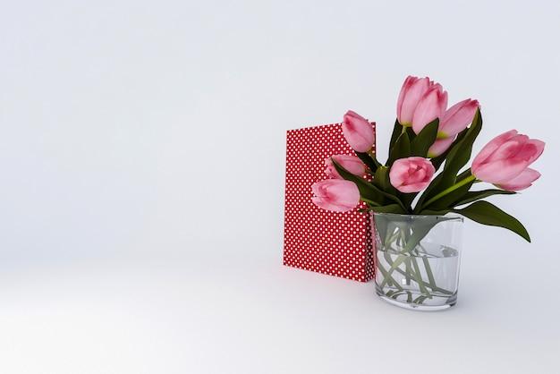 ギフトと白い背景の上の花の花束。 3dレンダリング。