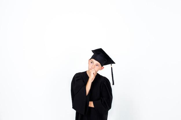학생 모자에있는 소년. 지식, 교육 및 성공적인 경력