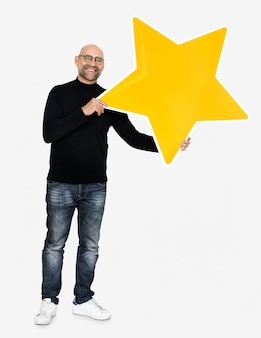 A cheerful man holding a star icon