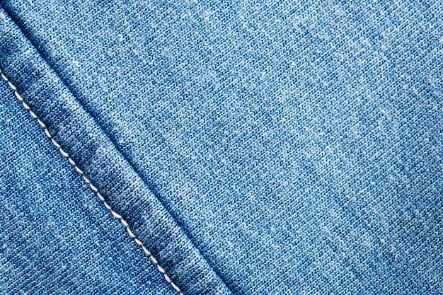 縫い目が付いているジーンズ生地のクローズアップ