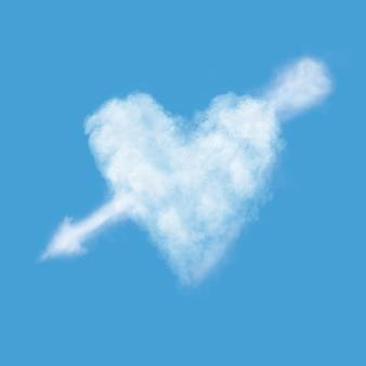 푸른 하늘에 화살표가있는 하트 모양의 구름