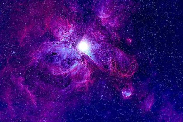 遠いピンクの銀河。星と星雲で。バックグラウンド。この画像の要素はnasaから提供されました。あらゆる目的のために。