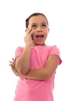 Девушка разговаривает по телефону на белом фоне