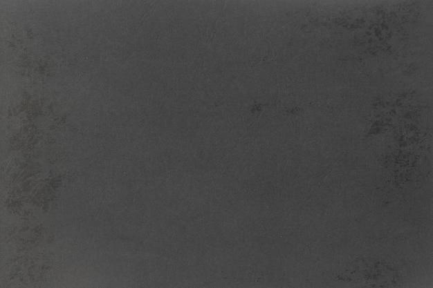 灰色のクラフト黒い紙の背景