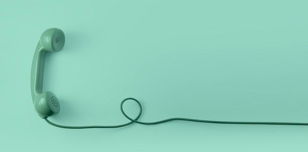 Зеленая винтажная телефонная трубка шкалы с зеленой предпосылкой.